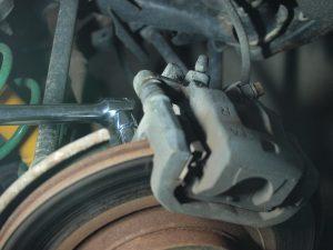 2 14mm bolts on Caliper bracket.
