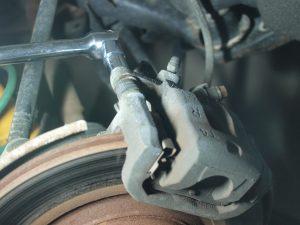 Loosen 4 bolts holding Caliper and Caliper Bracket  with Breaker Bar.