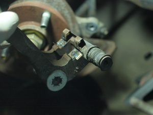 Clean up and re-grease where the brake pads seat
