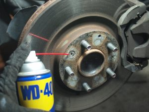spray WD40 on the screw holding the brake rotor.