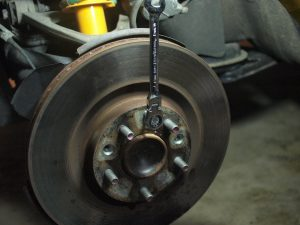 Use a bolt that fit to the hole on the rotor to pop off the Rotor from the hub.