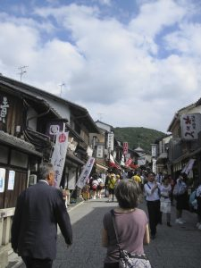 Often, in front of a big temple has a street full of stores.  selling souvenirs, snacks, food and drinks, etc.