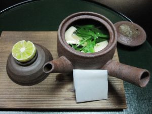 Matsutake Mushroom, fish meat, and Japanese  parsley are cooked in the broth.