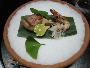 Grilled seafood on salt base.  salt suppose to hold the heat and keep the food warm.