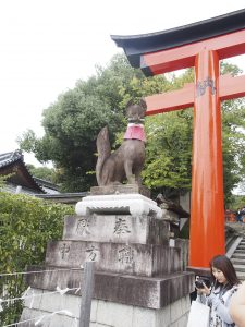 Usually the guardians of the shrine are dog, but Inari is a place where warship a fox god, thus it is a fox guardian.