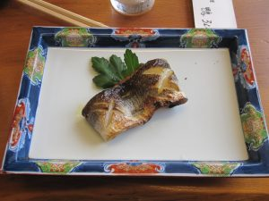 grilled fish.  Simple salt brings the fish flavor very well
