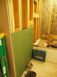 and some green drywall (moisture resistance), next to the bathtub.