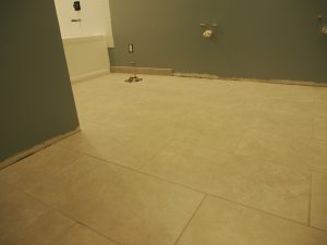 I grouted the floor.  It was was much much easier compare to the grouting the wall tiles.  Also I installed and grouted a few pieces of the base board tiles behind where toilet goes. so that we don't have to work behind the toilet once installed.