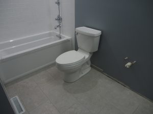 Toilet installed.  now the new bath room is quarter functional!
