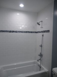 Installed shower hardwares.  One tile where hand shower hose is attached, cracked and needed to replace.  But thanks to Rick, it's done in no time.  He makes things look so much easier!!!